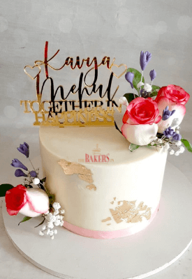 Elegant Floral Cake with edible gold leaves